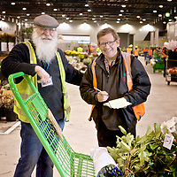 Traders exchange goods in the flower shed at the Melbourne's new wholesale market in Epping.
