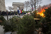 December, 8th, 2018 - Paris, Ile-de-France, France: Demonstrators making fires at barricades on Champs Elysees. The French 'Gilets Jaunes' demonstrate a fourth day. Their movement was born against French President Macron's high fuel increases. They have been joined en mass by students and trade unionists unhappy with Macron's policies. Nigel Dickinson