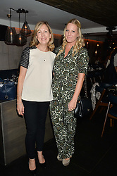 Left to right, JULIET HERD and ALICE NAYLOR-LEYLAND at a dinner to celebrate London Fashion Week SS 2015 and the opening of Ramusake at 92 Old Brompton Road, London on 15th September 2014.