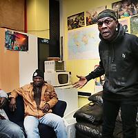 Nederland, Amsterdam , 16 april 2015.<br /> Illegalen in hun tijdelijk nieuwe onderkomen op de Jan Tooropstraat.<br /> Op de foto: Kouenou uit de Ivoorkust toont zijn ongenoegen.<br /> Foto:Jean-Pierre Jans