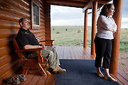 John Daniel Shannon, 48, a former US Army Senior Sniper, is sitting on his porch with his wife Torrey Shannon, 42, in Westcliffe, CO, USA, where he retired with his family after a serious brain injury inflicted by an insurgent sniper in Ramadi, Al Anbar Province, Iraq, on November 13th 2004. Daniel fought during the Second Battle of Fallujah and was then moved to nearby Ramadi. Daniel lost his left eye and has multiple health issues because of his injury: memory problems, balance problems, he can't smell and taste well anymore, he suffers from PTSD, has troubles with large crowds and city surroundings. This is the reason why he and his family moved to a quiet location on the Rocky Mountains. In 2007 Dan helped the Washington Post to uncover patients' neglect at the Walter Reed Army Medical Center; he also testified before Congress. Torrey, his wife, is a freelance writer and a contributor for the Huffington Post; she's also campaigning to improve the situation of veterans' families.