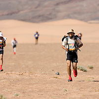 26 March 2007:  #738 Timothy O'Dowd of Great Britain runs across a plain near the end of the second stage (21.7 miles) of the 22nd Marathon des Sables between Khermou and jebel El Otfal. The Marathon des Sables is a 6 days and 151 miles endurance race with food self sufficiency across the Sahara Desert in Morocco. Each participant must carry his, or her, own backpack containing food, sleeping gear and other material.