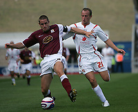 Photo: Lee Earle. <br /> Northampton Town v Swindon Town. Coca Cola Championship. 11/08/2007. <br /> Swindon's Blair Sturrock (R) battles with Chris Doig.