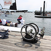 Skipper Sarah Everhart Skeels, (right), Tiverton, RI, and Cindy Walker, Middletown, RI, the only all female team competing in The Skud 18 class, prepare to leave the dock for competition with Sarah Everhart Skeels wheelchair on the dock during the C. Thomas Clagett, Jr. Memorial Clinic & Regatta at Newport, Rhode Island hosted by Sail Newport at Fort Adams. <br /> The Clagett is North America's premier event for sailors with disabilities with sailors competing in the 3 Paralympic class boats and is an integral part of preparation for athletes preparing for  Paralympic and world championship racing. Newport, Rhode Island, USA. 26th June 2015. Photo Tim Clayton