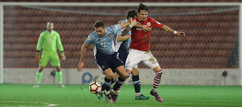 Blackpool's Clark Robertson and Barnsley's Adam Hammill fight for the ball<br /> <br /> Photographer Rachel Holborn/CameraSport<br /> <br /> Emirates FA Cup Third Round Replay - Barnsley v Blackpool - Tuesday 17th January 2017 - Oakwell Stadium - Barnsley<br />  <br /> World Copyright © 2017 CameraSport. All rights reserved. 43 Linden Ave. Countesthorpe. Leicester. England. LE8 5PG - Tel: +44 (0) 116 277 4147 - admin@camerasport.com - www.camerasport.com