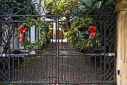 December 21, 2017 - Charleston, South Carolina, United States of America - The wrought iron gate of a historic home decorated with Christmas wreaths on the Battery in Charleston, SC. (Credit Image: © Richard Ellis via ZUMA Wire)
