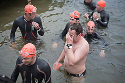 © Licensed to London News Pictures. 26/06/2011. Henley-on-Thames, UK. Exhausted competitors at the finnish. Swimmers take part in the Henley Swim at dawn this morning (26/06/2011). The annual event sees competitors swim the length of the 2.1km course of the Henley Royal Regatta on the River Thames, after arriving in darkness, and walking half a mile to the start at sunrise. See special instructions. Photo credit should read: Ben Cawthra/LNP