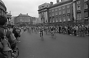 Nissan International Cycle Race..1986..01.10.1986..10.01.1986..1st October 1986..The Nissan Classic began today from Trinity College,Dublin. The offical race starter was The Taoiseach,Dr Garrett FitzGerald TD. He was accompanied by the Minister for Sport,Mr Sean Barrett TD..Sean Kelly was returning to defend his title but his opposition included Greg LeMond, the 1983 world champion and the winner of the Tour de France of the previous July. Roche was out due to his injured leg. Adri van der Poel was back with 1980 Tour de France winner and 1985 world champion Joop Zoetemelk. Teun van Vliet was back too. The winner of the green jersey of the Tour de France that July, Eric Vanderaerden was there as well as Australians Phil Anderson and Alan Peiper as well the Scottish cyclist Robert Millar...And they are off. Picture taken as the cyclists depart Trinity College,Dublin, on the first stage of the round Ireland,Nissan Classic Cycle Race..
