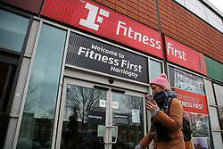 © Licensed to London News Pictures. 05/01/2021. London, UK. A woman walks past a branch of Fitness First in Harringay, north London. <br /> Chancellor Rishi Sunak announced that businesses in the hospitality sector including restaurants and gyms are to receive a one-off grant worth up to £9,000 to help them through to the spring. <br /> Prime Minister Boris Johnson announced on Monday 4 January 2021 that England goes into third national lockdown until at least 22 February 2021, with households ordered to stay home and only go outside for the specific reasons. Photo credit: Dinendra Haria/LNP