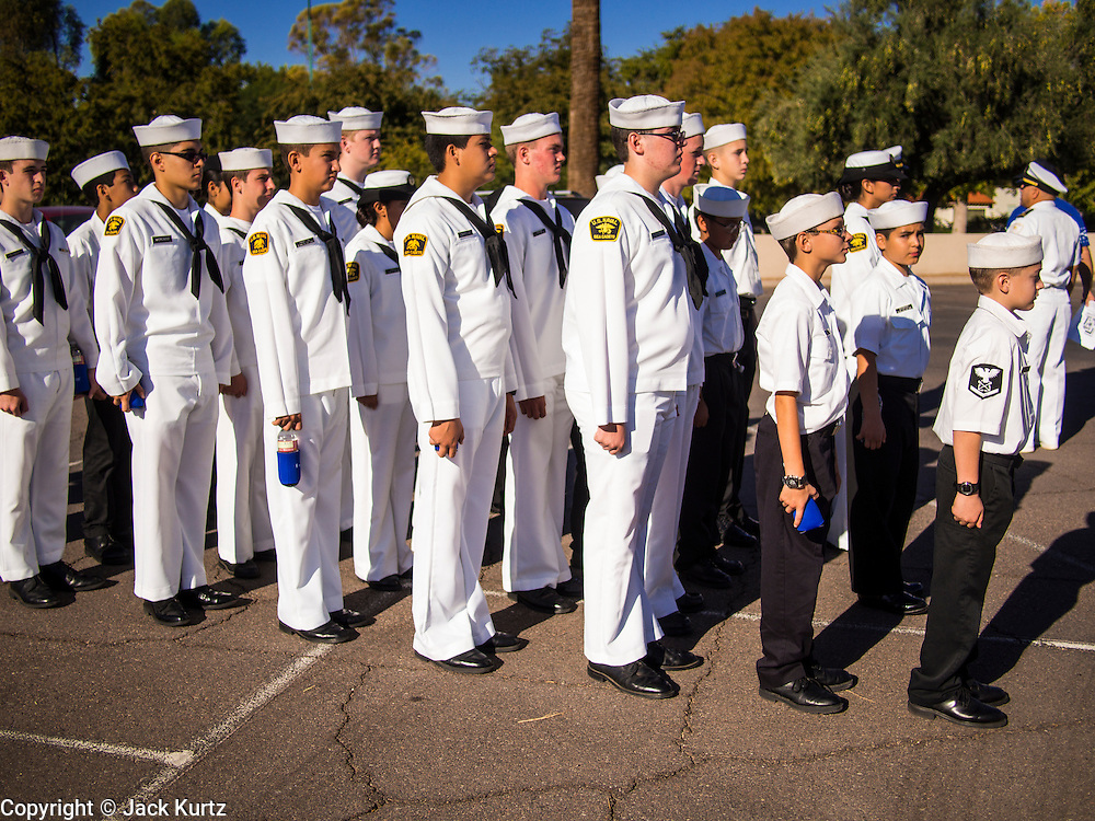 """11 NOVEMBER 2013 - PHOENIX, AZ: Sea Cadets, a society of high school students interested in joining the US Navy, line up before the Veterans Day Parade in Phoenix. The Phoenix Veterans Day Parade is one of the largest in the United States. Thousands of people line the 3.5 mile parade route and more than 85 units participate in the parade. The theme of this year's parade is """"saluting America's veterans.""""     PHOTO BY JACK KURTZ"""