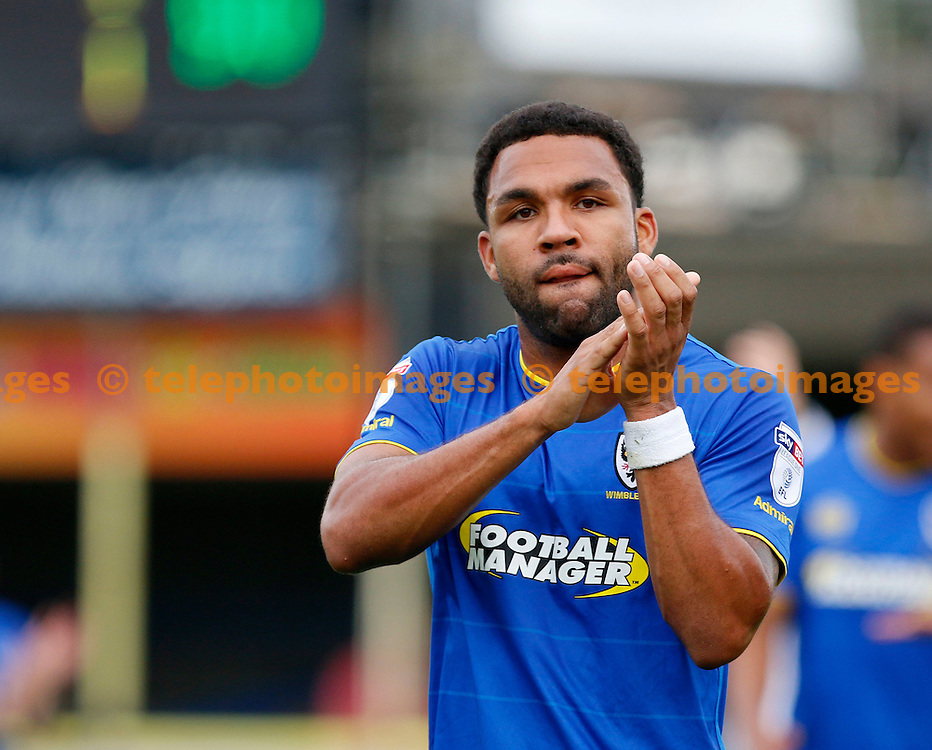 AFC Wimbledon's Andy Barcham applauds the fans during the Sky Bet League 1 match between AFC Wimbledon and Shrewsbury Town at the Cherry Red Records Stadium in Kingston. September 24, 2016.<br /> Carlton Myrie / Telephoto Images<br /> +44 7967 642437