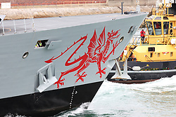 © Licensed to London News Pictures. 31/08/2011. Portsmouth, UK.  Dragon,the Navy's newest Type 45 anti-air warfare destroyer, enters her home port of Portsmouth for the first time where she will be commissioned in the afternoon. The Dragon logo on her bow will be removed prior to this. BAE Systems workers can be seen on her helicopter deck. Photo credit : Bryan Moffat/LNP