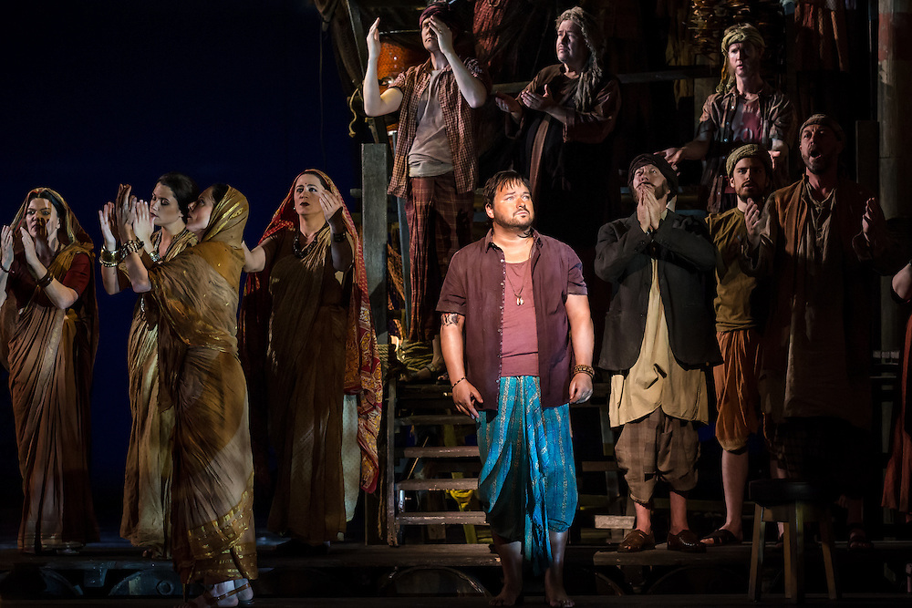 """LONDON, UK, 17 October, 2016.  Robert McPherson (in purple shirt, centre, as """"Nadir"""") rehearses with members of the cast for the revival of director Penny Woolcock's production of Bizet's opera """"The Pearl Fishers"""" at the London Coliseum for the English National Opera.  The production opens on 19 October."""