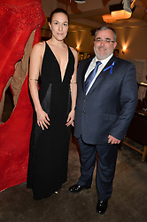MARY ALICE MALONE and NEIL SWAN CEO of Starlight at the unveiling of a Very Special Malone Souliers Christmas Tree, In Support Of Starlight Children's Foundation held at The Club Cafe Royal, Regent Street, London on 2nd December 2015.