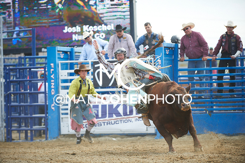 Bull rider Josh Koschel of Nunn, CO rides 842 Super Cowboy at the Rancho Mission Viejo Rodeo in San Juan Capistrano, CA.  <br /> <br /> <br /> UNEDITED LOW-RES PREVIEW<br /> <br /> <br /> File shown may be an unedited low resolution version used as a proof only. All prints are 100% guaranteed for quality. Sizes 8x10+ come with a version for personal social media. I am currently not selling downloads for commercial/brand use.