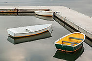 A trio of dinghies at rest on the still waters of Town Cove in Orleans.