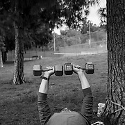 A fitness trainer works with a client in a West Hills park. All gyms and fitness centers were closed as non-essential businesses forcing trainers and their clients to find alternatives.