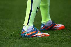 Detail of the boots of Barcelona's Lionel Messi embroidered with the name of his son Thiago