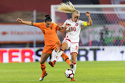 (L-R) Sherida Spitse of the Netherlands women, Pernille Harder of Denmark women during the FIFA Women's World Cup 2019 play off first leg qualifying match between The Netherlands and Denmark at the Rat Verlegh stadium on October 05, 2018 in Breda, The Netherlands