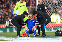 Everton's Tom Davies is helped off the pitch by medical staff during the Premier League match at the bet365 Stadium, Stoke.