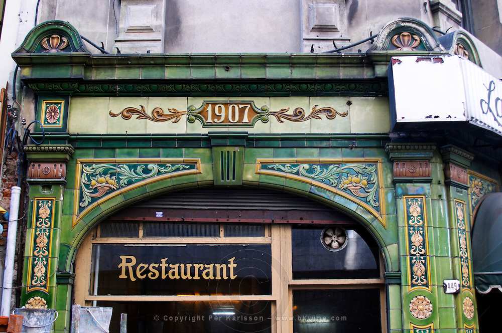 The front of a restaurant with art noveau jugend decoration with a sign saying 1907, probably the date of construction, in the Old Town, Ciudad Vieja. Montevideo, Uruguay, South America