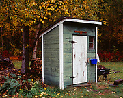 """Historic Alaska Railroad Outhouse built in 1917 for the Wasilla Section House and restored by LeRoi Heaven who says this """"Two seater was built so people could share the morning newspaper,"""" Matanuska Valley, Alaska."""