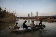 Syrians crossing the Orontes river which marks the border between Turkey and Syria on February 27th 2013, near Hacipasa, Turkey.