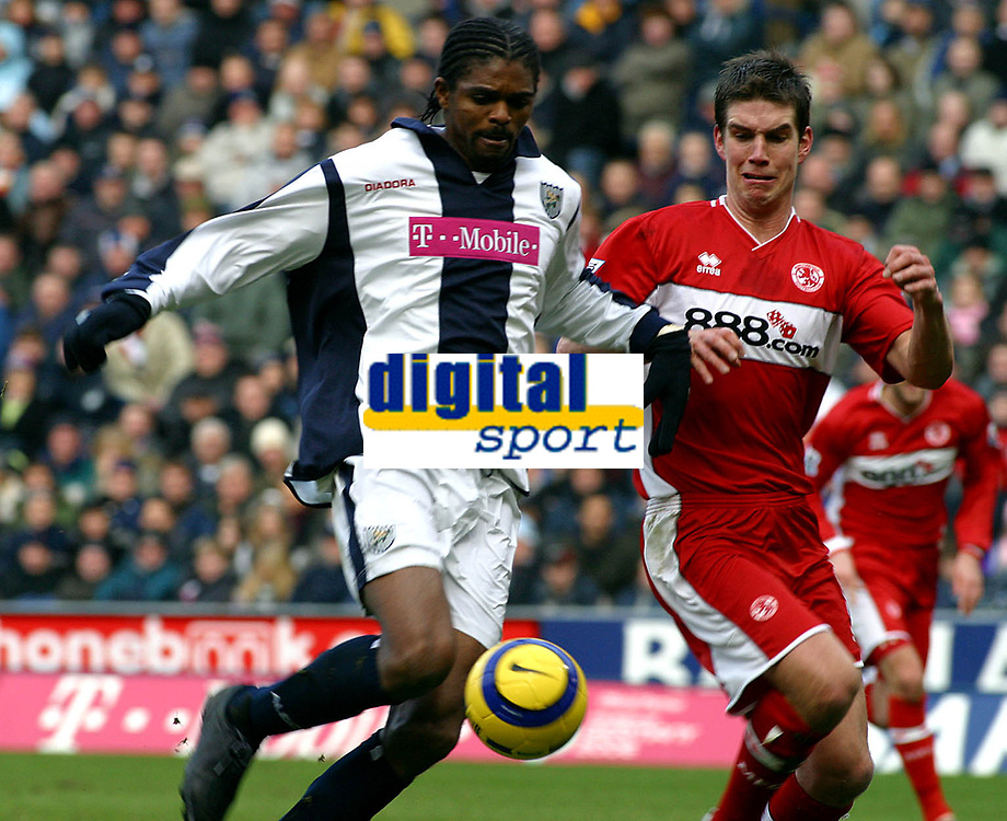 Photo: Dave Linney.<br />West Bromwich Albion v Middlesbrough. The Barclays Premiership. 26/02/2006West Brom's Kanu(L) heads goalwards with Chris Riggott in the chase