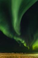 Aurora over Beaufort Sea and cemetery of Kaktovik on the North Slope of Alaska. Autumn. Evening.