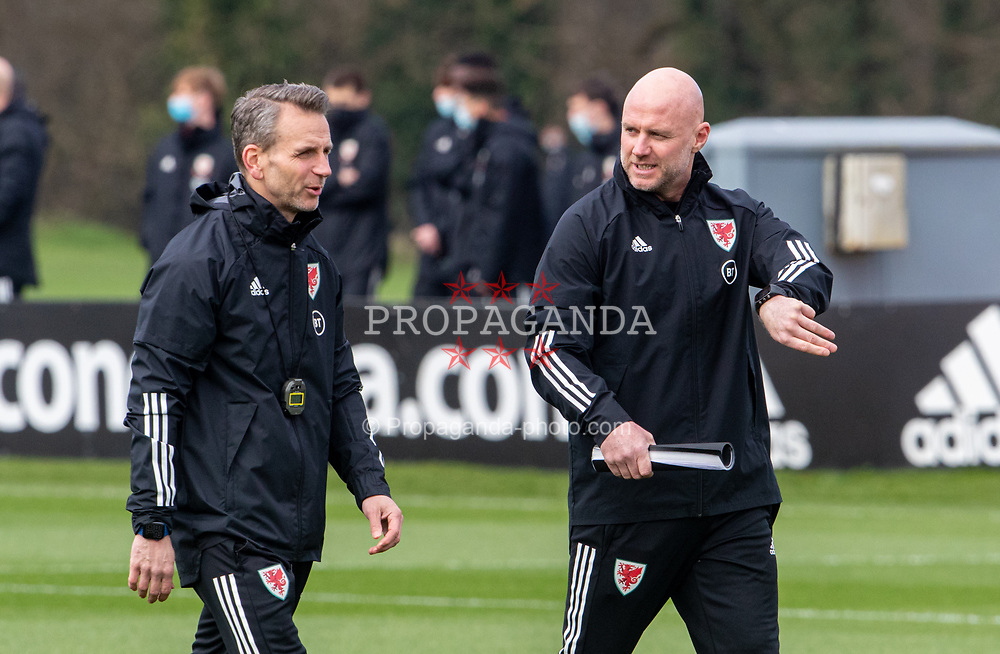 CARDIFF, WALES - Tuesday, March 23, 2021: Wales' care-taker manager Robert Page (R) and assistant coach Albert Stuivenberg during a training session at the Vale Resort ahead of the FIFA World Cup Qatar 2022 Qualifying game against Belgium. (Pic by David Rawcliffe/Propaganda)