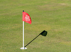 Detail of flag in hole of putting green at Gullane Golf Course in East Lothian , Scotland, United Kingdom