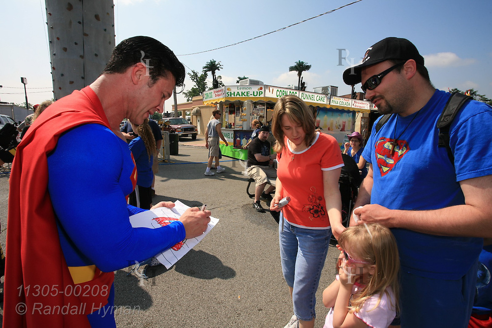Superman devotee, Danny Kelley, dresses the part while signing autographs and mixing with crowds at Superman Celebration; Metropolis, Illinois.