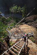 Zach Podell-Eberhardt (front) and Henry climb the steep ladders at Logan Creek, West Coast Trail, British Columbia, Canada.