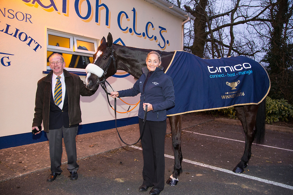 19th March 2016, Gordon Elliott trained Don Cossack homecoming to Summerhill<br /> Jim McGee pictured with his daughter Louise Dunne and Cheltenham winner - Don Cossack<br /> Photo: David Mullen /www.cyberimages.net / 2016