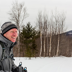 A man cross country skiing in Maine's Katahdin Woods and Waters National Monument.