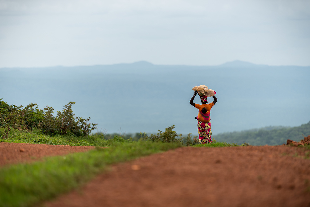 3 June 2019, Djohong, Cameroon: A woman looks out over the valley near Borgop refugee camp. The Borgop refugee camp is located in the municipality of Djohong, in the Mbere subdivision of the Adamaoua regional state in Cameroon. Supported by the Lutheran World Federation since 2015, the camp currently holds 12,300 refugees from the Central African Republic.