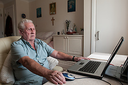 Pensioner in supported housing using a computer