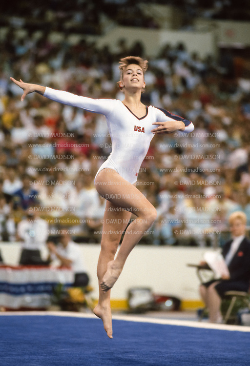 PHOENIX - APRIL 24:  Lisa Panzironi of the USA competes in the floor exercise during a USA - USSR gymnastics meet on April 24, 1988  at the Arizona Veterans Memorial Coliseum in Phoenix, Arizona.  (Photo by David Madison/Getty Images)