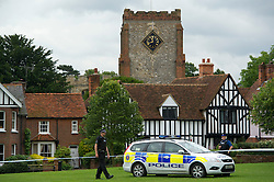 © London News Pictures. 10/07/2012. Writtle, UK. Police guard the entrance to All Saints Church in Writtle, Essex where the body of 64 year-old Peter Reeve was found in the graveyard on July 10, 2012. Peter Reeve was being hunted by police in connection with the murder of Pc Ian Dibell in Clacton.  Photo credit: Ben Cawthra/LNP.