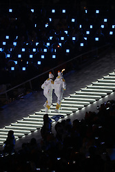 February 9, 2018 - PyeongChang, South Korea - Two athletes from the Koreas' unified women's hockey team, South Korean player PARK JONG-AH and North Korean player CHUNG SU-HYON, carry the torch up the gigantic staircase during the Opening Ceremony for the 2018 Pyeongchang Winter Olympic Games, held at PyeongChang Olympic Stadium. (Credit Image: © Scott Mc Kiernan via ZUMA Wire)