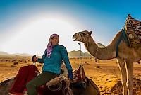 Tourist on camel ride in Arabian Desert, Wadi Rum, Jordan.
