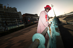 © Licensed to London News Pictures . 27/09/2015 . Brighton , UK . Labour Party activist JOSEPH AFRANE ( 51 from Battersea in London ) in the morning sun outside the Labour Party Conference on Brighton seafront . The 2015 Labour Party Conference . Photo credit : Joel Goodman/LNP