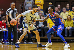 Jan 19, 2019; Morgantown, WV, USA; West Virginia Mountaineers forward Esa Ahmad (23) looks to make a move while defended by Kansas Jayhawks guard Marcus Garrett (0) during the first half at WVU Coliseum. Mandatory Credit: Ben Queen-USA TODAY Sports
