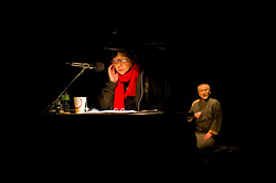 "© Copyright licensed to London News Pictures. 05/11/2010. Radio Narrator (Ryoko Tateishi) with Old Sasuke (Yoshi Oida) in the background. Complicite present ""Shun-Kin"" at the Barbican, London. Directed by Simon McBurney, based on the writings of Jun'ichiro Tanizaki."