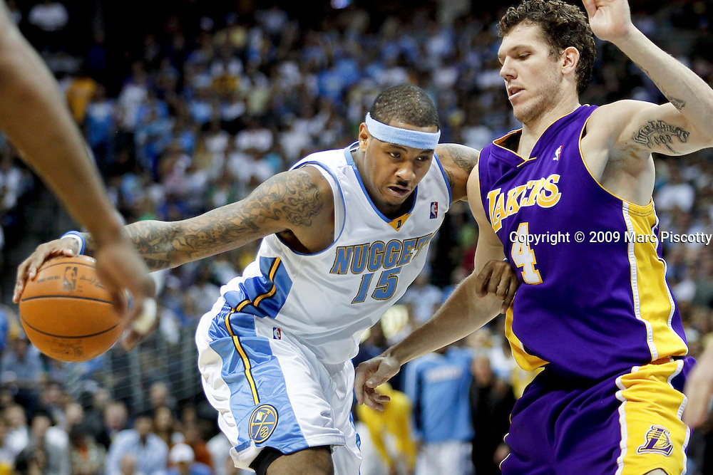 The Denver Nuggets' Carmelo Anthony (#15) drives the lane on the Los Angeles Lakers' Luke Walton (#4) during the second half of Game 4 of the NBA Western Conference Finals in Denver May 25, 2009. The Nuggets won the game 120-101 to even the series at 2-2. .(Photo by Marc Piscotty / © 2009)