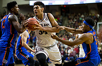 Texas A&M center Tyler Davis (34) tries to drive the lane against Florida forward Kevarrius Hayes (13) and guard KeVaughn Allen (5) during the first half of an NCAA college basketball game Tuesday, Jan. 2, 2018, in College Station, Texas. (AP Photo/Sam Craft)