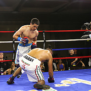 Zhankizh Turatov of Almaty, Kazakhstan (L) stands over a fallen Gustavo Garibay of Mexico during a Nelsons Promotions boxing match at the Boca Raton Resort  and Club on Friday, May 26, 2017 in Boca Raton, Florida.  (Alex Menendez via AP)