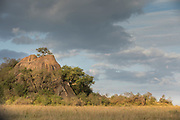 Scenic landscape with view of a rock formation and trees in the savannah, Serengeti National Park, Tanzania