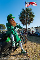 Pete Rosati of Daytona Beach, FL is head to toe ready for Saint Patricks Day with a lot of Blarney and his 1977 Iron Head Harley-Davidson Sportster. Daytona Bike Week. FL, USA. March 15, 2014.  Photography ©2014 Michael Lichter.