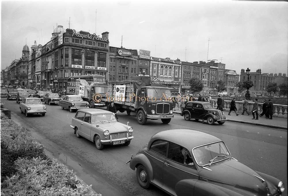 07/09/1963<br /> 09/07/1963<br /> 07 September 1963<br /> I.C.T. Computers for ESSO being delivered. The AEC Mercury trucks crossing O'Connell Bridge in Dublin city centre. International Computers and Tabulators were a British based computer company that provided the first computers used in Ireland. These images were taken for Hugo B. Patterson, I.C.T. Regional Executive for Ireland.